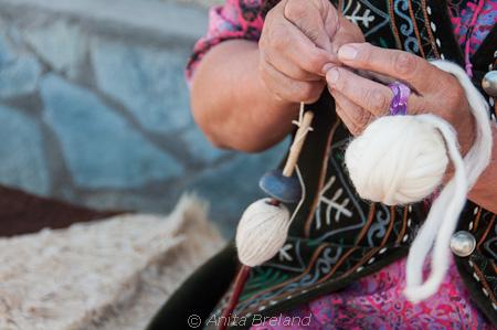 Pulling wool thread for a shurdak, Kyrgyzstan