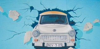 Car bursting through the wall by Birgit Kinder-East Side Gallery, Berlin, Germany