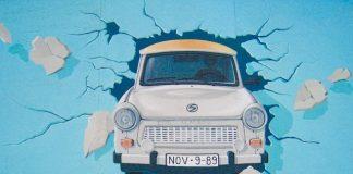 Car bursting through the wall by Birgit Kinder-East Side Gallery, Berlin, Germany