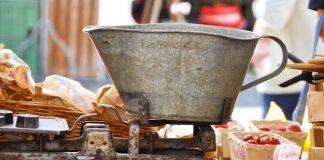 Traditional beam scale and tin bucket, Basel market, Switzerland