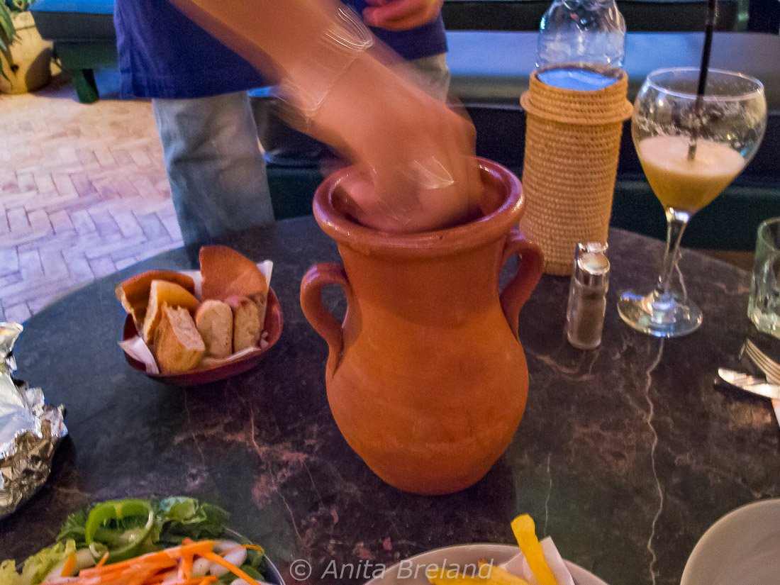 Opening a tanjia at Cafe Clock in Fez, Morocco