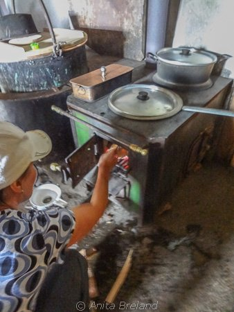 Firing up the wood-burning stove