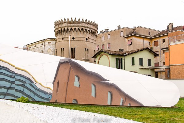 The exterior shows the modern museum in context with the old city of Modena.