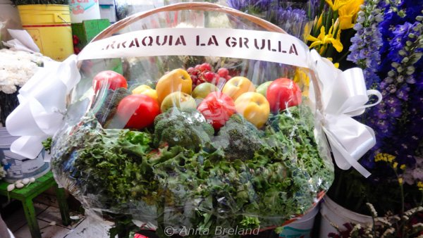 basket containing fruits and greens
