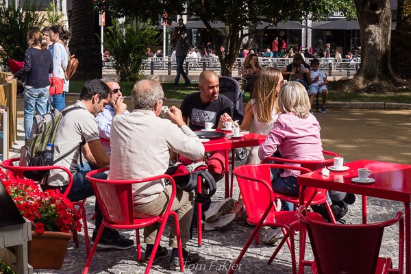 Drinking coffee at an outdoor kiosk in Lisbon