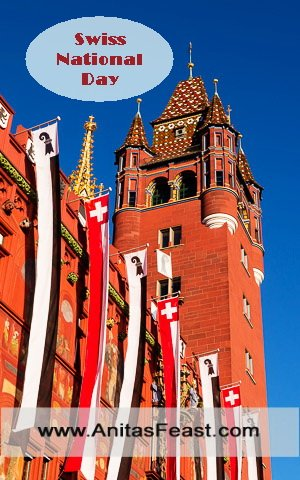 Basel's Town Hall floats Swiss and Cantonal flags for the Swiss National Day