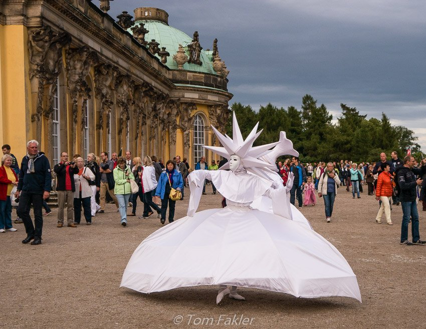 During Potsdamer Schlössernacht, dancers make their way through the crowds around Sanssouci Palace.