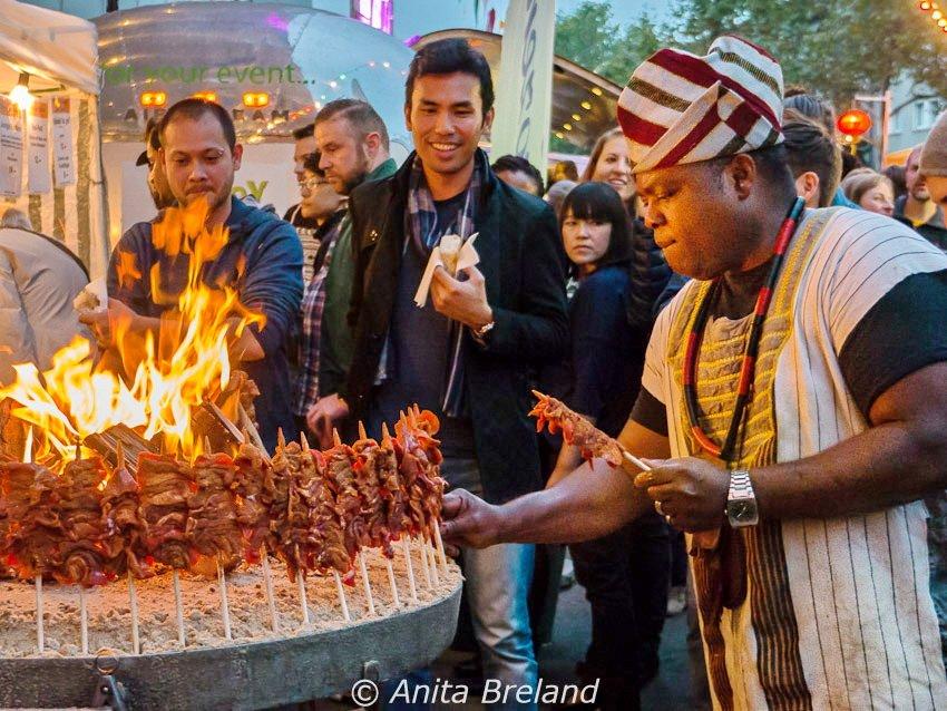 Meat skewers roasting over coals