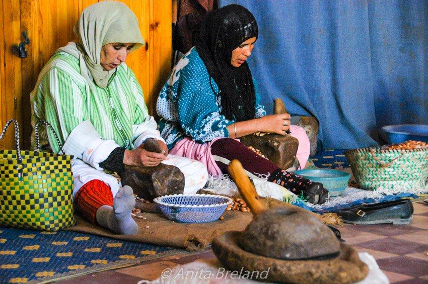 Berber women husking argan nuts