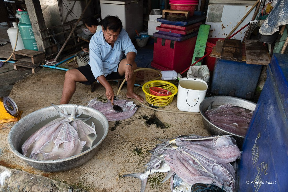 Preparing fish for salting Kokut Island