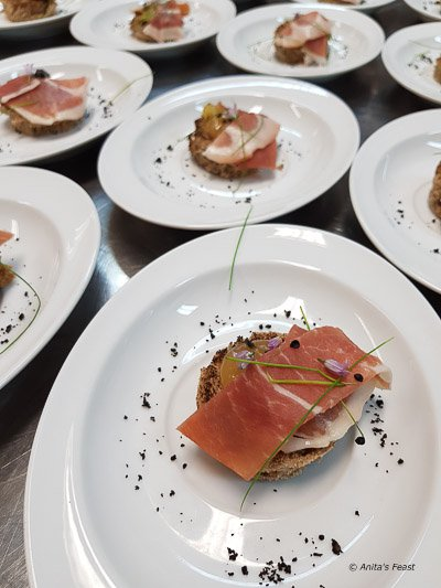 toasted artisan bread with aged ham