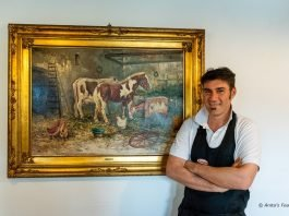 Chef Guido Mangarelli before a painting