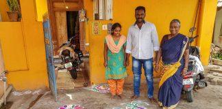 FAmily standing near a kolan