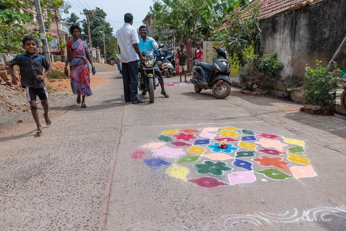 Kolam with people walking past