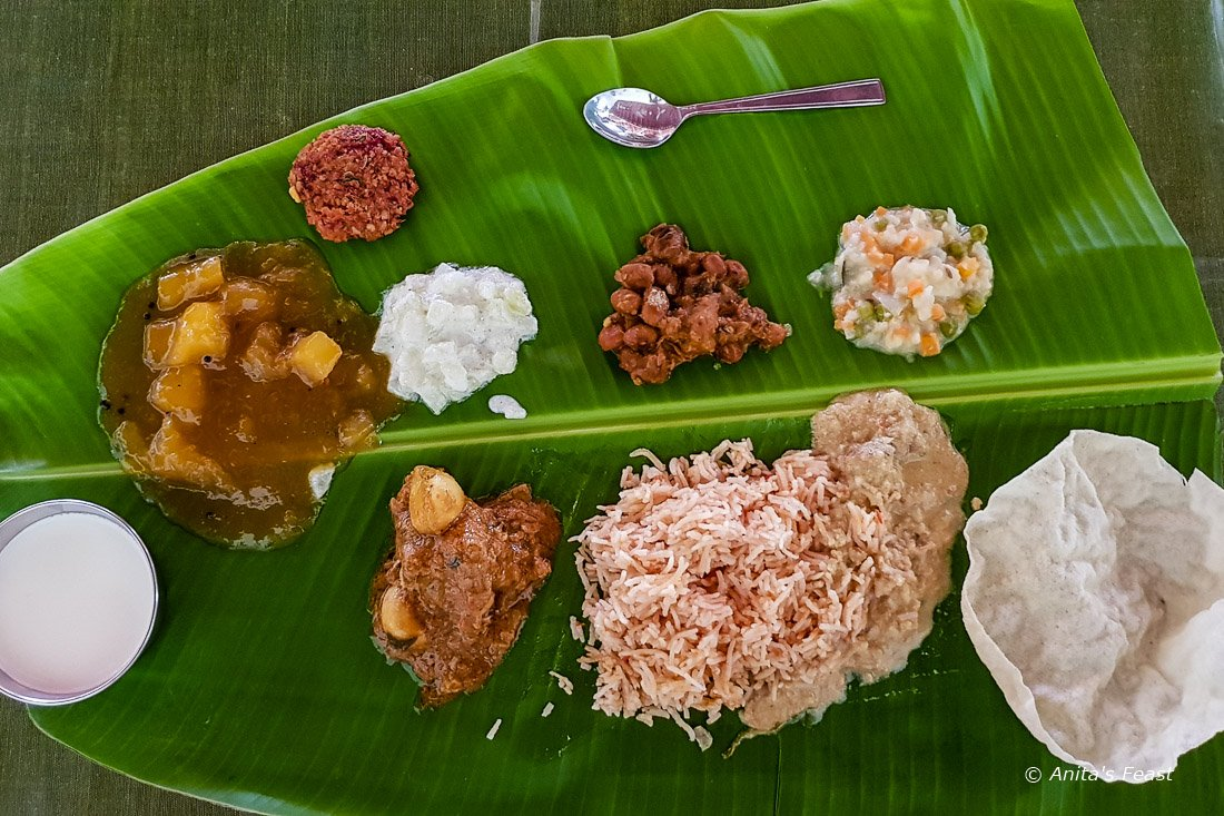 A South Indian banana leaf meal with nine dishes