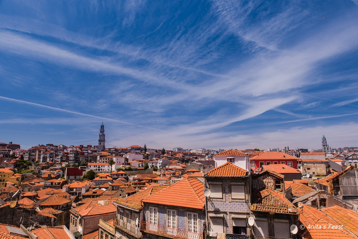 Porto roof tops with contrails in the sky