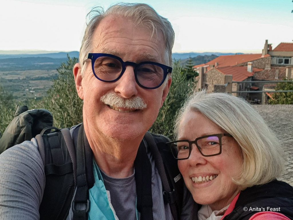 Man and woman smiling at scenic overlook
