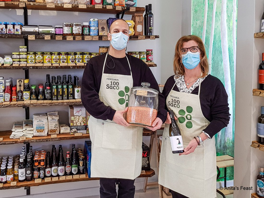 Masked man and woman in an organic grocery